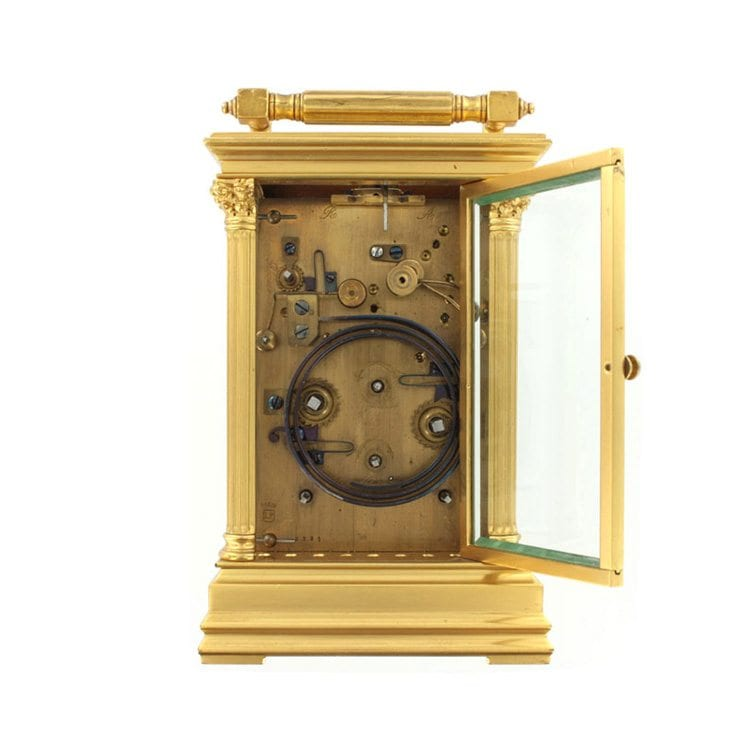 Antique gold clock open in product photography example