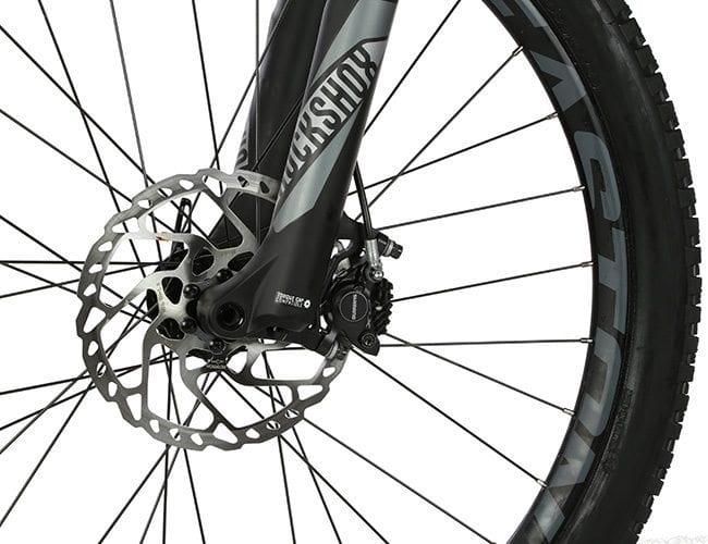 close up bike rim zoom metal shiny tire product photo