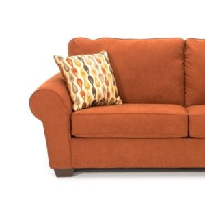 desert orange love seat couch with accent pillow product photography example
