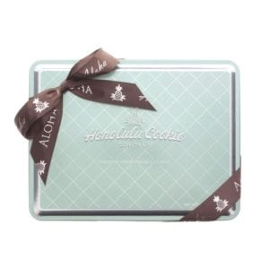 Honolulu cookie in clear blue and brown container in grocery and food product photography example